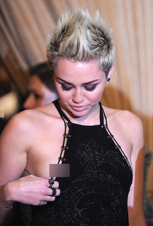 Miley-Cyrus-1670768a-1378262580.jpg