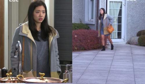 : Eunsang cũng diện một chiếc áo cổ lông, cô nàng giản dị với váy suông cùng màu và boots đen.