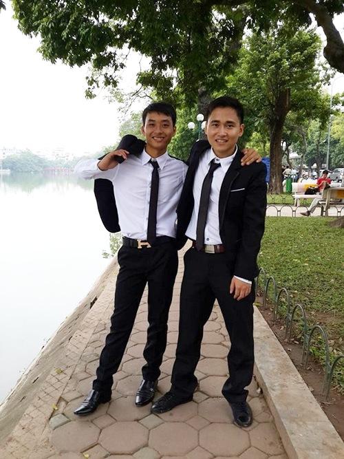 Bùi Thành Quang (trái).