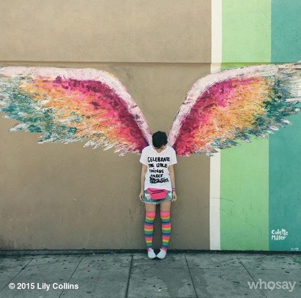 Lily Collins giả làm thiên thần khi chụp ảnh đường phố.