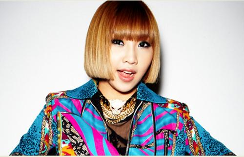 Minzy ra mắt năm 15 tuổi, là dancer trong nhóm nhạc cá tính 2NE1. Nữ ca sĩ hiện đã rời nhóm, hoạt động solo. Cô được khen ngày càng xinh đẹp và gợi cảm hơn.