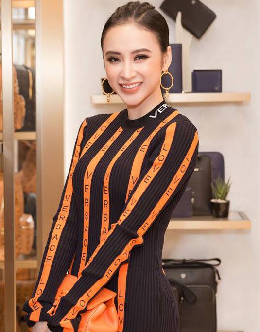 <p> Chiêu chọn tông trang điểm phù hợp với trang phục giúp Angela Phương Trinh dù diện đồ rực rỡ đến mấy trông cũng không bị quá sặc sỡ, lòe loẹt. Với bộ váy màu cam, nữ diễn viên khéo trang điểm đôi môi màu cam đất đầy ăn ý.</p>