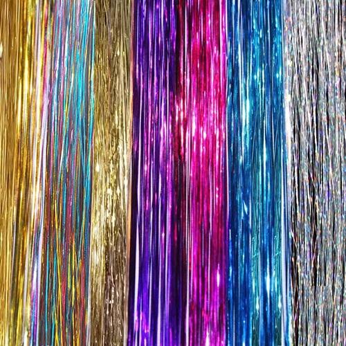Đan cài sợi kim tuyến lên mái tóc là cách đơn giản để giúp bạn có vẻ ngoài tỏa sáng, tạo  điểm nhấn đặc biệt mà không hề gây tổn hại tóc như tẩy hay  nhuộm. Kiểu tóc tạm thời này là lựa chọn hoàn hảo cho các idol luôn phải  đổi mới hình tượng.