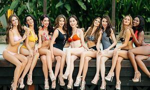 Phương Nga được xếp ngồi giữa khi chụp ảnh bikini ở Miss Grand International
