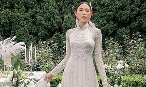 Bạn gái Phillip Nguyễn mặc áo dài cưới